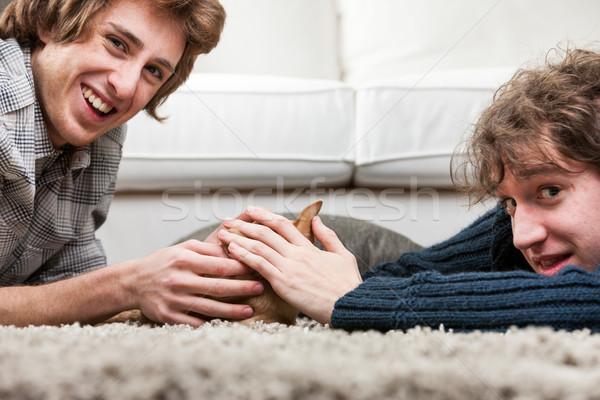 Twee jonge mannen weinig hond samen alle Stockfoto © Giulio_Fornasar