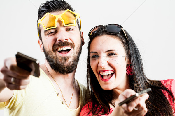 thrilled couple taking mobile photographs and selfies Stock photo © Giulio_Fornasar