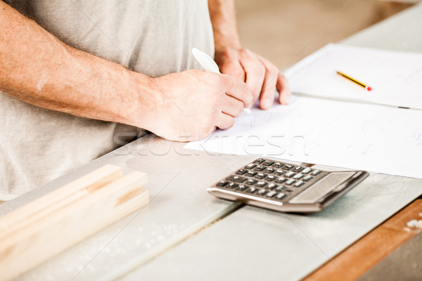 woodworker planning calculating and measuring Stock photo © Giulio_Fornasar