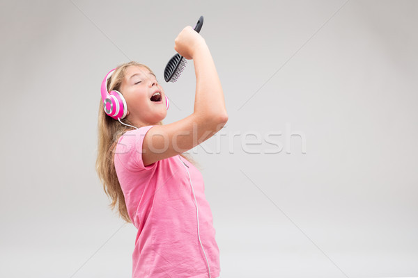 girl with headphones pretending to be a singer Stock photo © Giulio_Fornasar