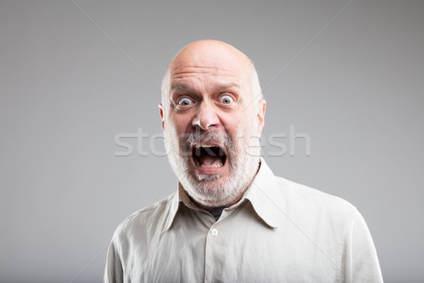 strong exaggerated fear expression of an old man Stock photo © Giulio_Fornasar