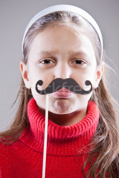 Little girl with fake mustache laying down the law Stock photo © Giulio_Fornasar