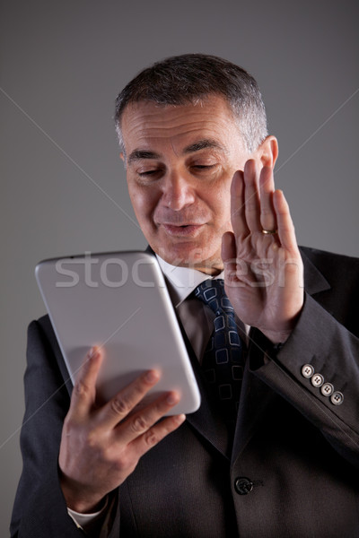grandfather saluting children on a tablet Stock photo © Giulio_Fornasar