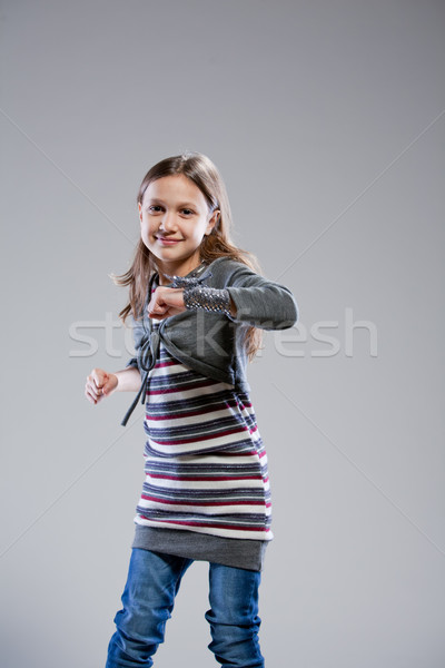 little girl dancing on a neutral background Stock photo © Giulio_Fornasar