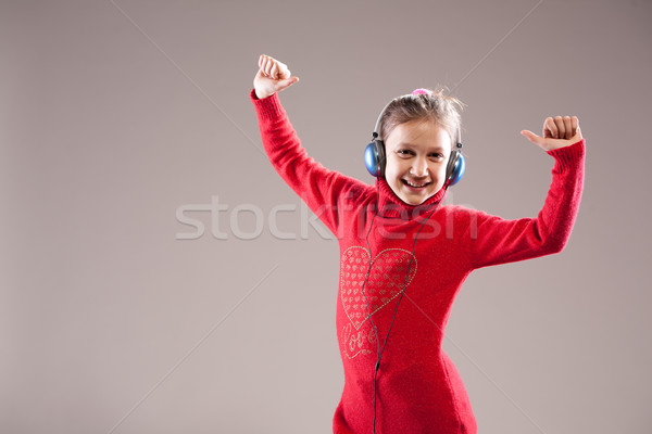 Photo stock: Réussi · petite · fille · danse · gagnant · écouter · casque