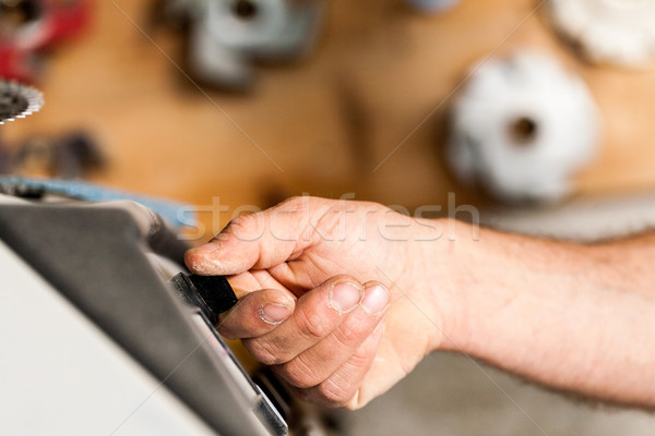 switching on a machine in joinery workshop Stock photo © Giulio_Fornasar