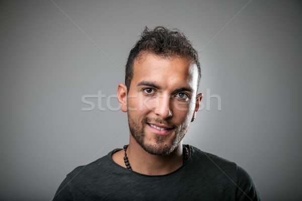 Fiatal latinamerikai férfi mosolyog portré zöld Stock fotó © Giulio_Fornasar