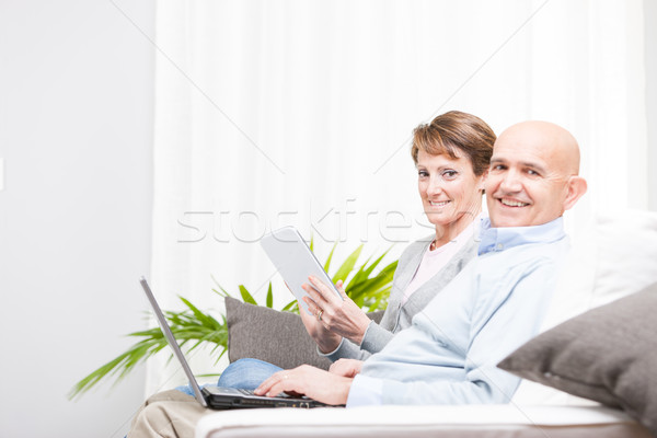 Happy married couple relaxing at home Stock photo © Giulio_Fornasar
