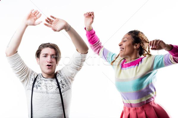 Young happy couple enjoying on plain background Stock photo © Giulio_Fornasar