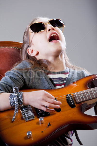 girl with guitar and sunglasses Stock photo © Giulio_Fornasar