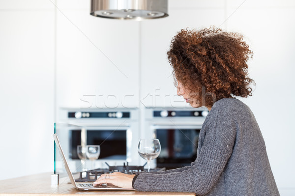 unrecognizable woman with laptop in the kitchen Stock photo © Giulio_Fornasar