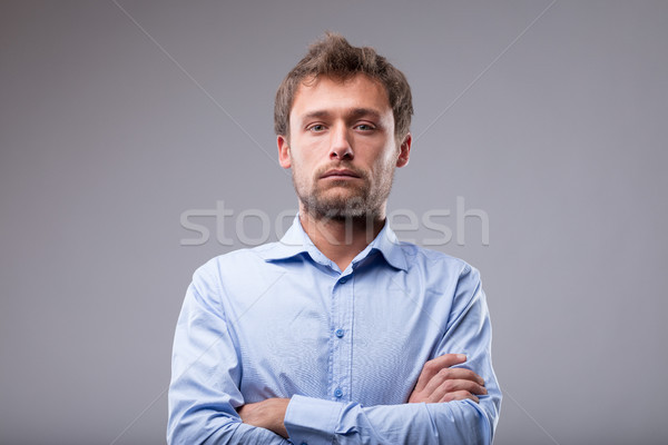 Attractive man with a deadpan expression Stock photo © Giulio_Fornasar
