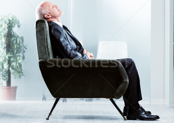 Stock photo: Tired businessman taking a moment to relax