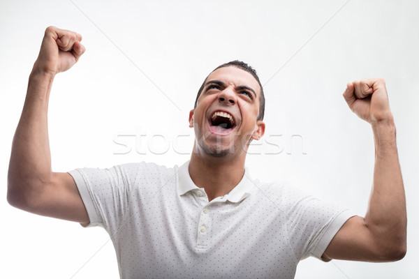 Excited man cheering and punching the air Stock photo © Giulio_Fornasar