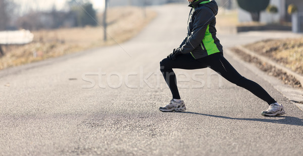 woman warming-up before her running Stock photo © Giulio_Fornasar