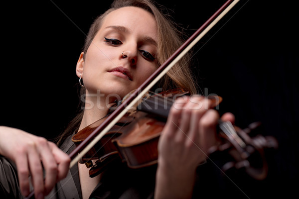 serious pretty woman playing violin on black Stock photo © Giulio_Fornasar