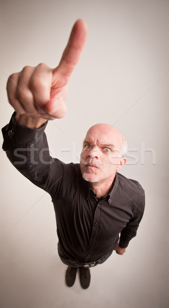 finger of a man telling off in wide angle Stock photo © Giulio_Fornasar