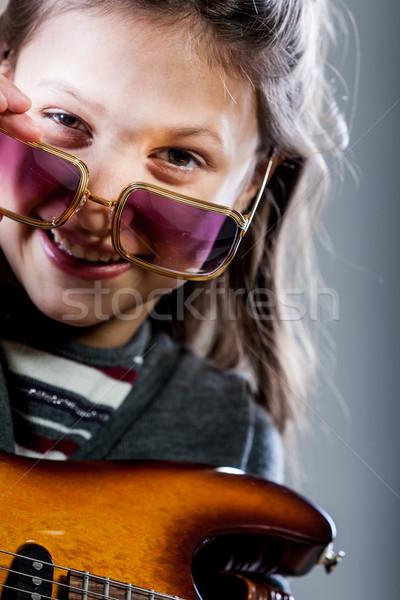 little girl playing as a guitar hero rockstar Stock photo © Giulio_Fornasar