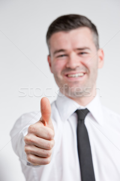 thumb up for happy young man Stock photo © Giulio_Fornasar