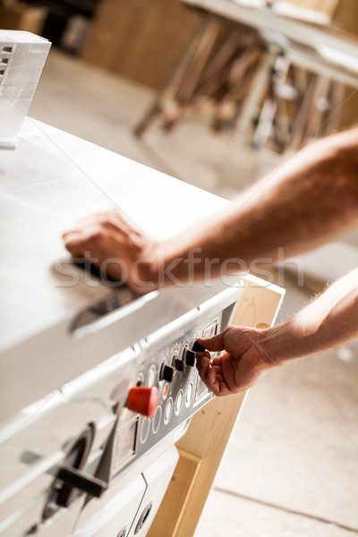 turning on or off a machine in a woodworker workshop Stock photo © Giulio_Fornasar