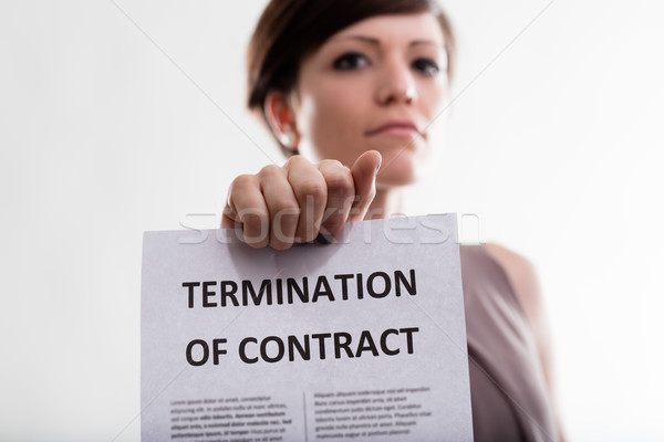 Serious woman holding Termination of Contract Stock photo © Giulio_Fornasar