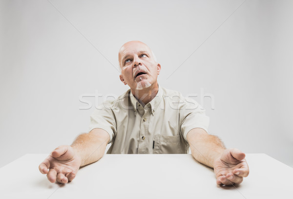 Stressed senior man looking up imploringly Stock photo © Giulio_Fornasar