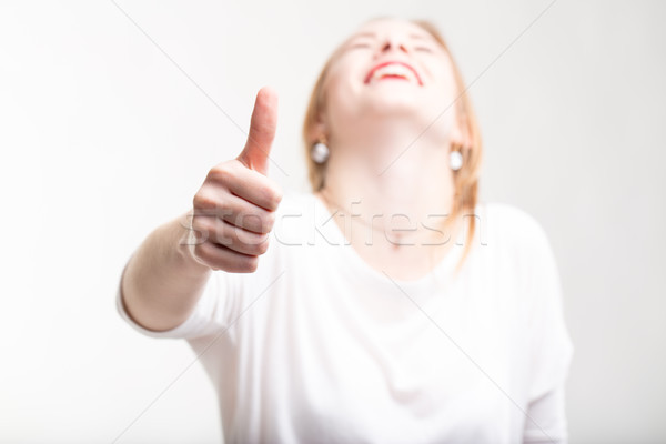 Elated excited woman giving a thumbs up Stock photo © Giulio_Fornasar