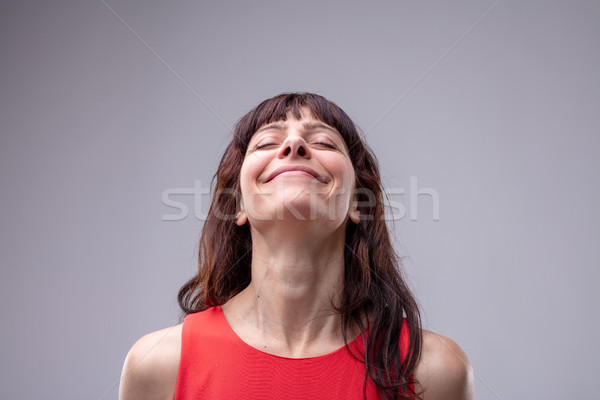 Happy woman with her head thrown back Stock photo © Giulio_Fornasar