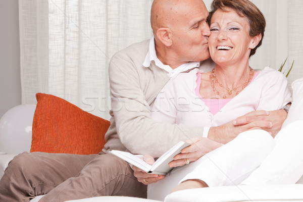 Stock photo: mature couple loving each other at home