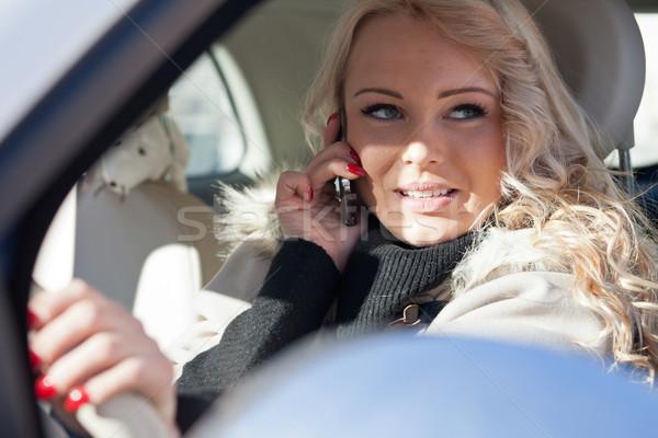 Mooie vrouw rijden gevaarlijk gedrag meisje telefoon Stockfoto © Giulio_Fornasar