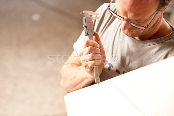 carpenter measuring a board with calipers Stock photo © Giulio_Fornasar