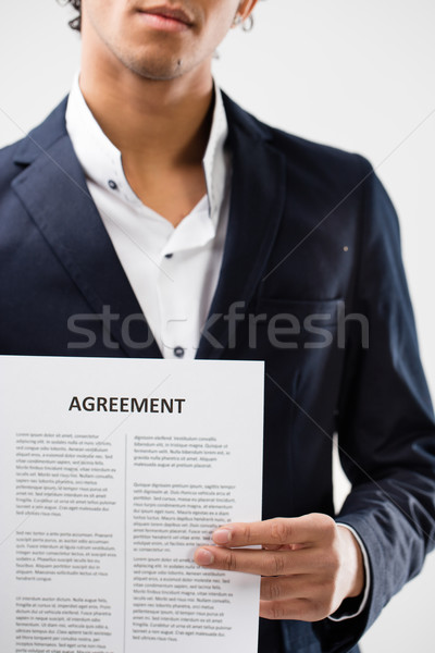 agreement held by young man Stock photo © Giulio_Fornasar
