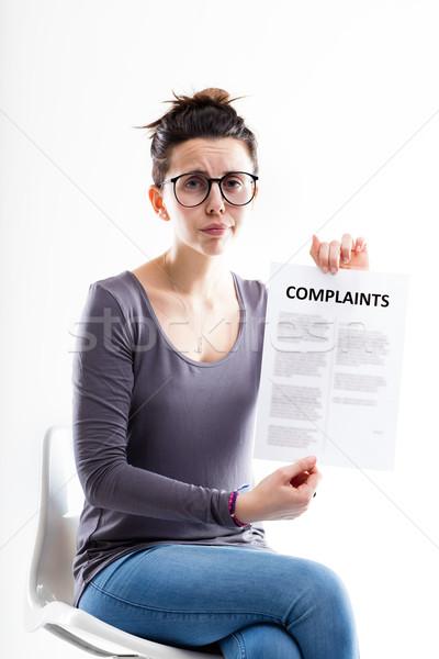 Vergadering vrouw tonen vorm triest bezorgd Stockfoto © Giulio_Fornasar