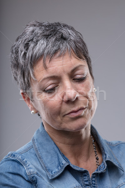 Thoughtful sad or depressed senior woman Stock photo © Giulio_Fornasar