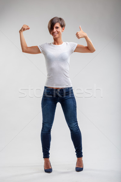 Fit healthy muscular woman giving a thumbs up Stock photo © Giulio_Fornasar