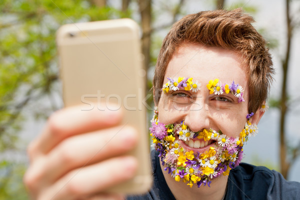 Homme couvert fleurs barbe Photo stock © Giulio_Fornasar