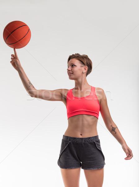 Vrouw balancing basketbal vinger jonge vrouw lichaam Stockfoto © Giulio_Fornasar