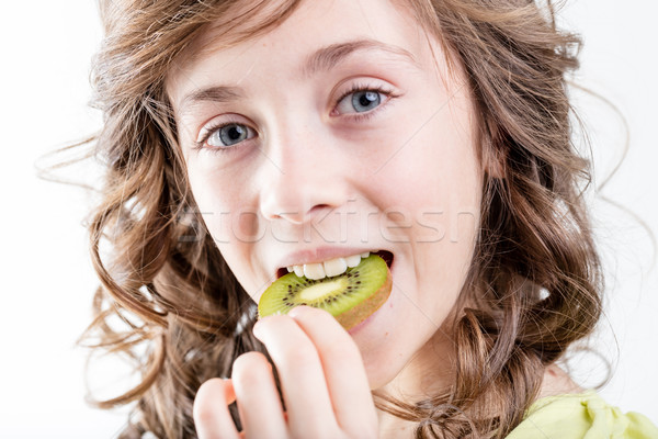girl eating a kiwi slice Stock photo © Giulio_Fornasar