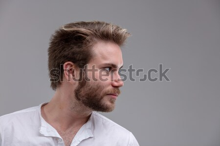Happy bearded man looking to the side Stock photo © Giulio_Fornasar