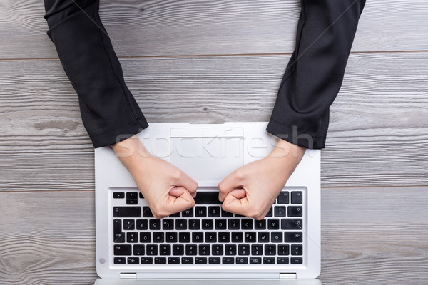 Above view of clenched fists hitting keyboard Stock photo © Giulio_Fornasar