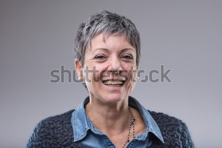 Smiling happy older woman with short hair Stock photo © Giulio_Fornasar