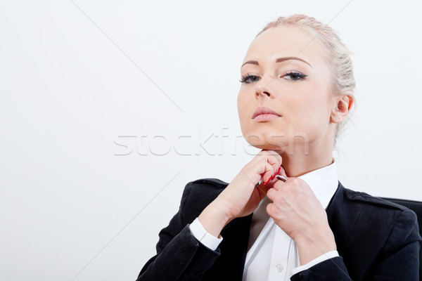 blonde executive buttons up her shirt Stock photo © Giulio_Fornasar