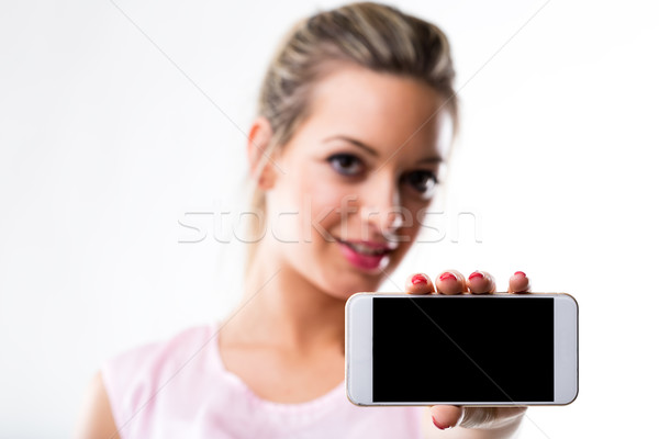 focus on the screen of a smartphone held by a woman Stock photo © Giulio_Fornasar
