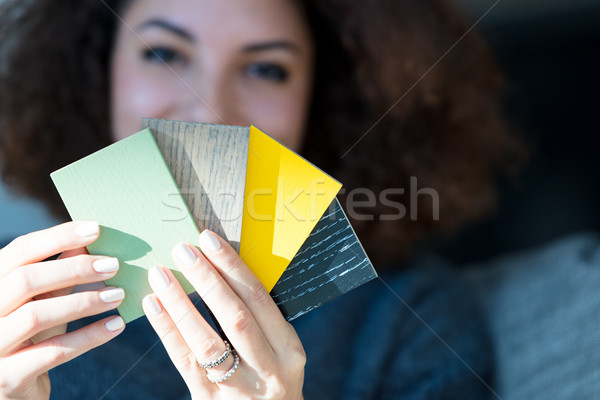 Woman doing redecorating looking at wood samples Stock photo © Giulio_Fornasar