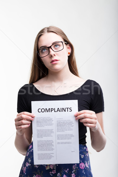 Serious young woman with a long list of Complaints Stock photo © Giulio_Fornasar