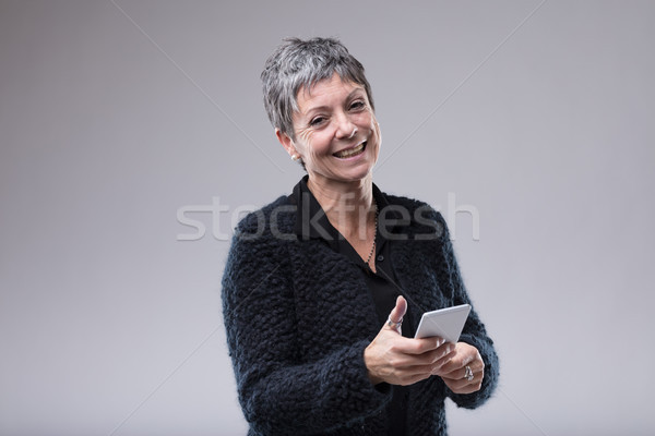 Charismatic older woman with a sweet smile Stock photo © Giulio_Fornasar