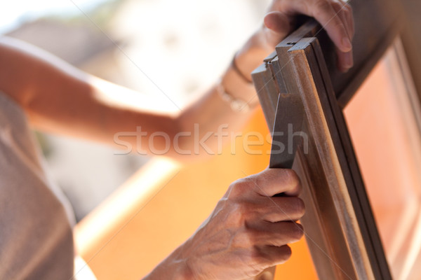 Woman polishing a window with a putty knife Stock photo © Giulio_Fornasar