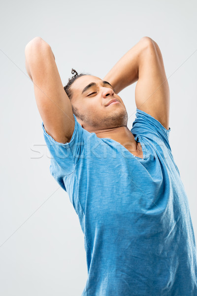 Unatkozik lusta fiatalember nyújtás fiatal jóképű férfi Stock fotó © Giulio_Fornasar