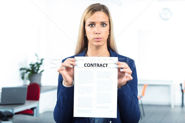 woman holding and showing a contract Stock photo © Giulio_Fornasar
