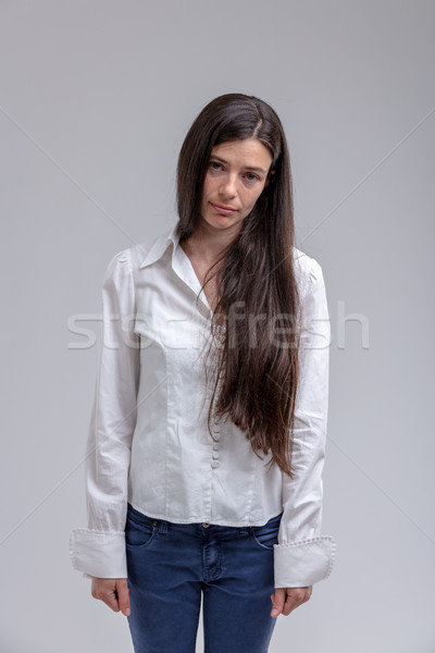 Portrait of young long-haired unmotivated woman Stock photo © Giulio_Fornasar